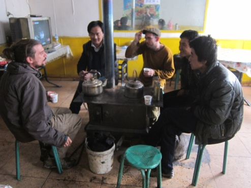 attempting to stay warm in sub-zero temperatures, pit stop, Xinjiang