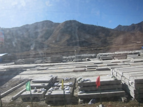 factories and mining operations scar the countryside in Gansu, Tibet