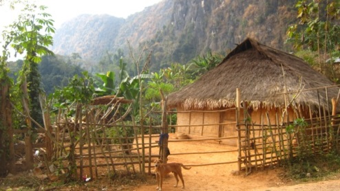 typical village dwelling with meticulously swept yard