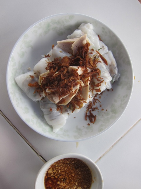 hot rice-crepe rolls with crispy fried onion and peanut-chili dipping sauce