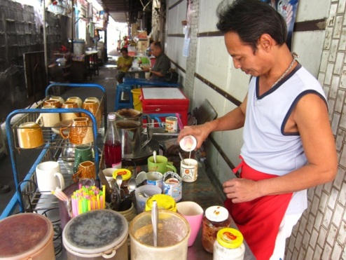 our favourite coffee guy in an alley off Th Rambuttri