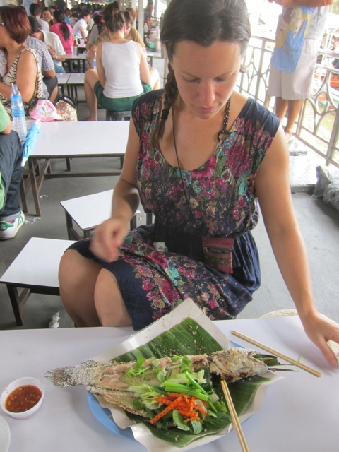 Me tucking into a sal-crust grilled 'head fish' at Taling Chan