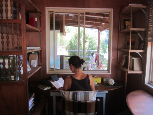 Me at work in my writing studio (which was once the bathroom... a matter of priorities - research over cleanliness)