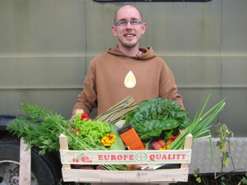 Richie with a box of veggies harvested from The Patch. Permaculture principle number three: obtain a yield!